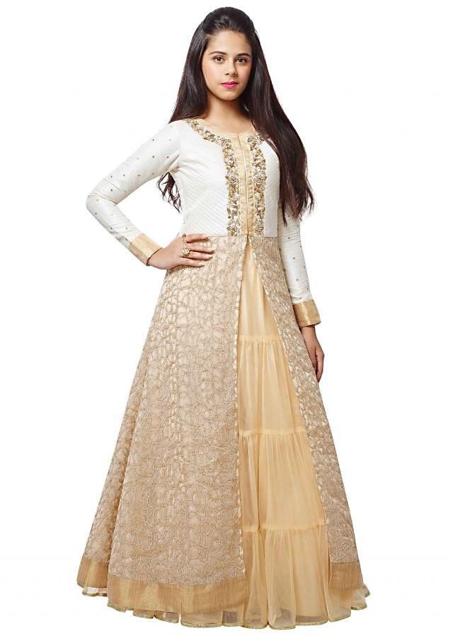Cream anarkali suit in embroidered net.