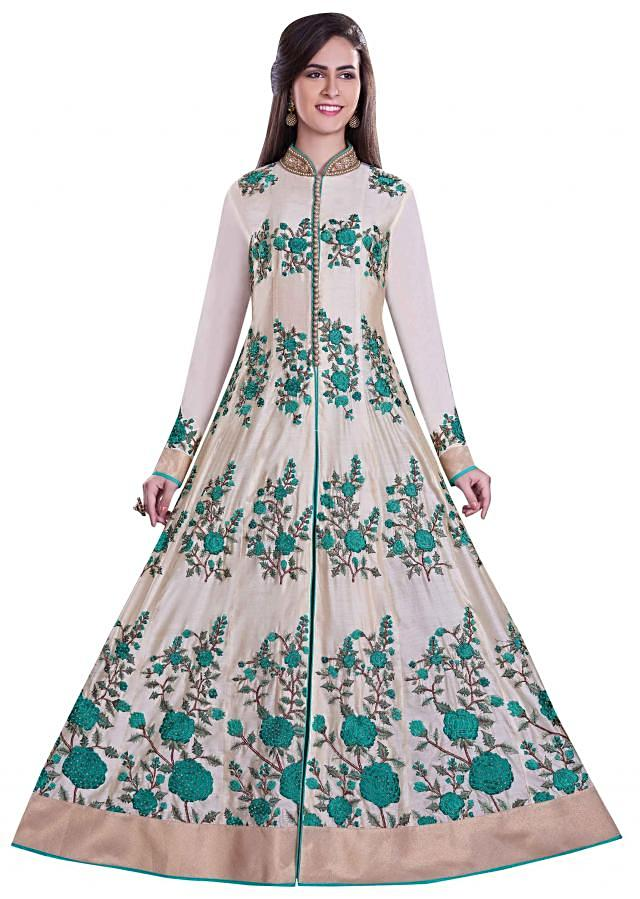 Cream anarkali suit in green resham embroidery
