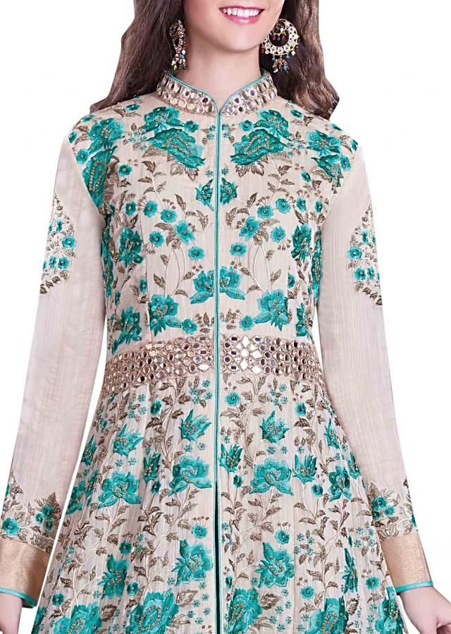 Cream anarkali suit in teal resham embroidery