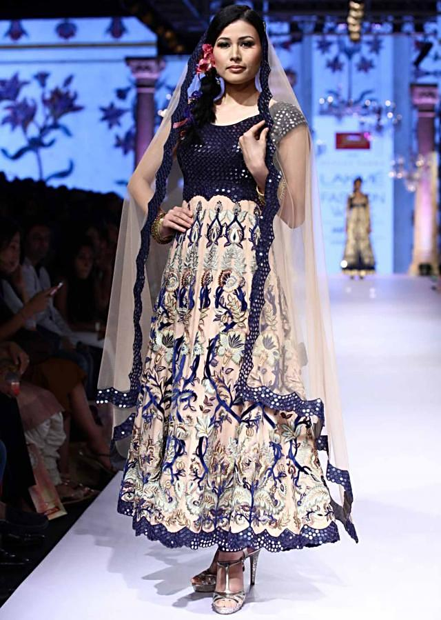 Model in cream anarkali with mirror embellished navy blue bodice walks the ramp for Suneet Verma for his collection Decorative Arts of India at Lakme Fashion Week Summer Resort 2015