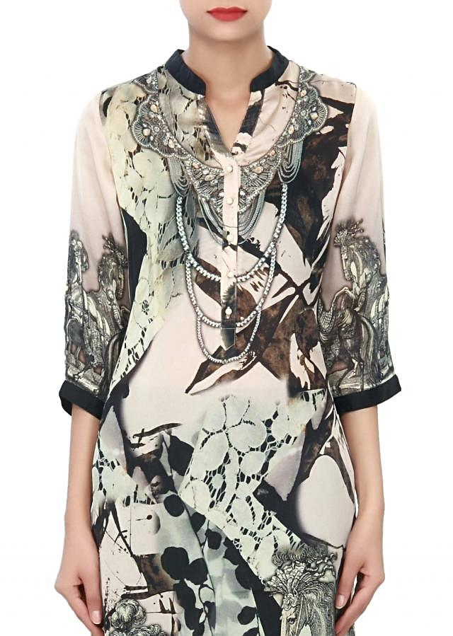 Cream and black kurti enhanced in pearl placket only on Kalki