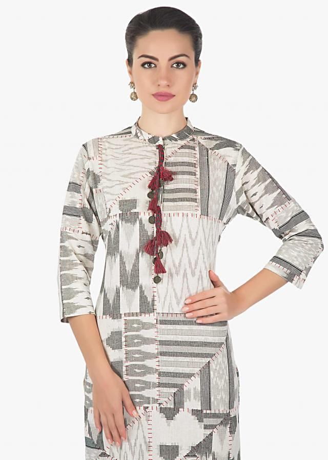 Cream and black kurti featuring with fancy tassel on placket only on Kalki
