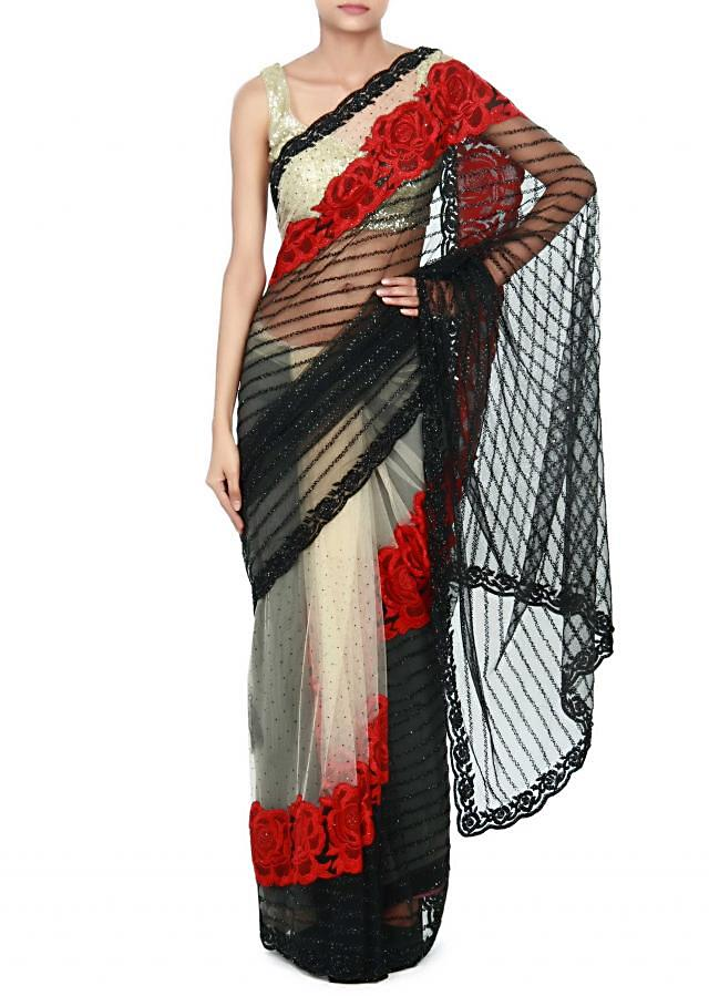 Cream and black saree adorn in resham embroidery only on Kalki