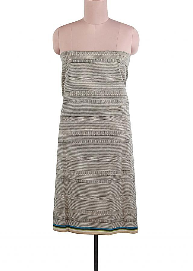 Cream and black unstitched suit features with stripe print only on Kalki