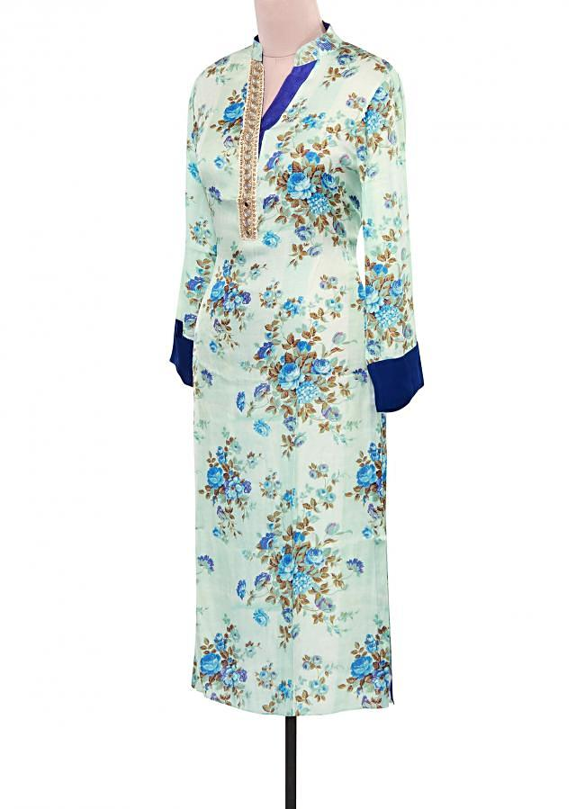 Cream and blue floral printed kurti adorn in mirror embellished placket only on Kalki