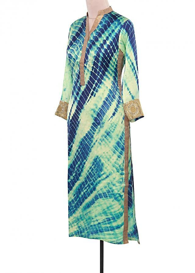 Cream and blue tie and dye kurti adorn in lurex placket only on Kalki