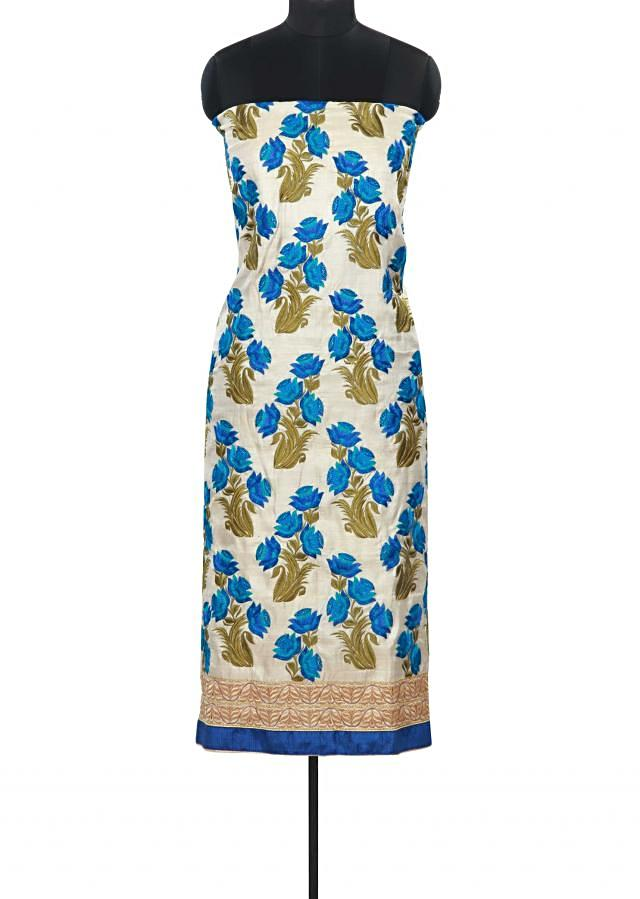 Cream and blue unstitched suit adorn in floral resham butti only on Kalki