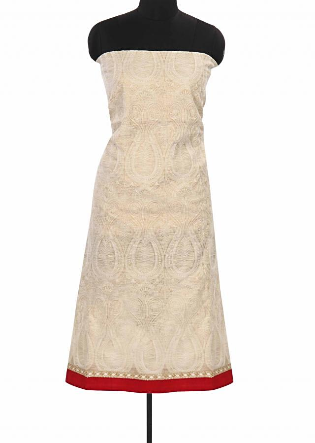 Cream and gold unstitched suit in paisley motif only on Kalki