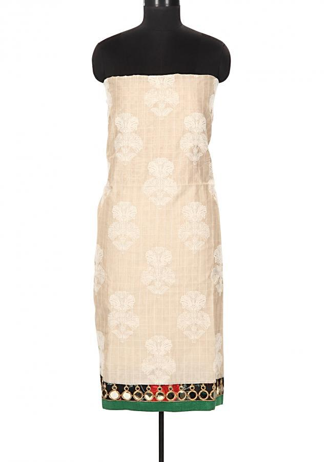 Cream and green unstitched suit enhanced in thread butti