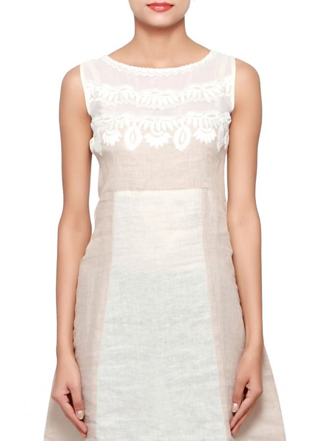 Cream and grey kurti in linen and georgette embellished in thread embroidery only on Kalki