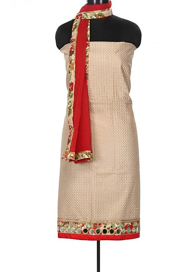 Cream and maroon unstitched suit enhanced in thread butti