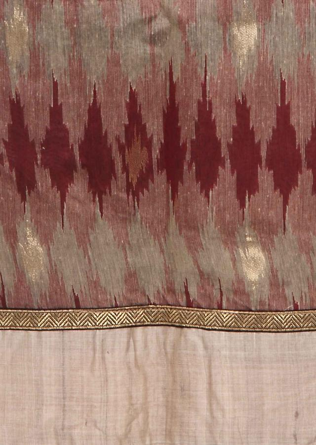 Cream and maroon unstitched suit in ikkat print only on Kalki