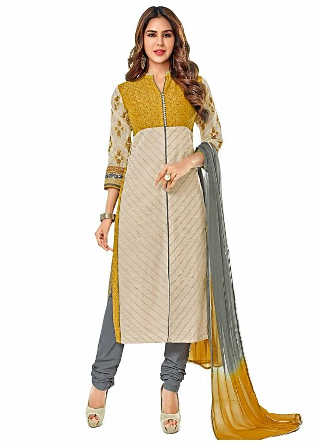 Cream and mustard suit with embroidered sleeve only on Kalki