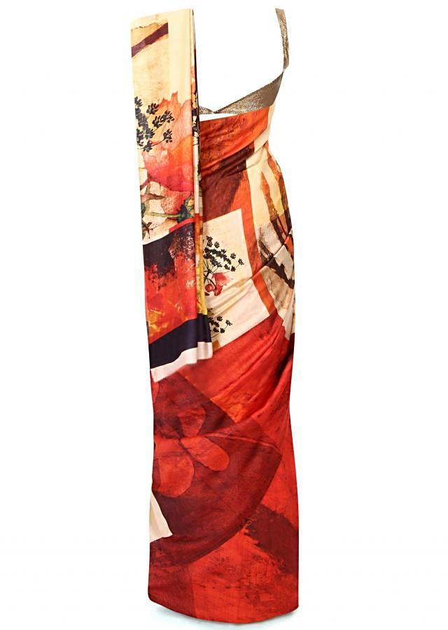 Cream and orange saree in floral print only on Kalki