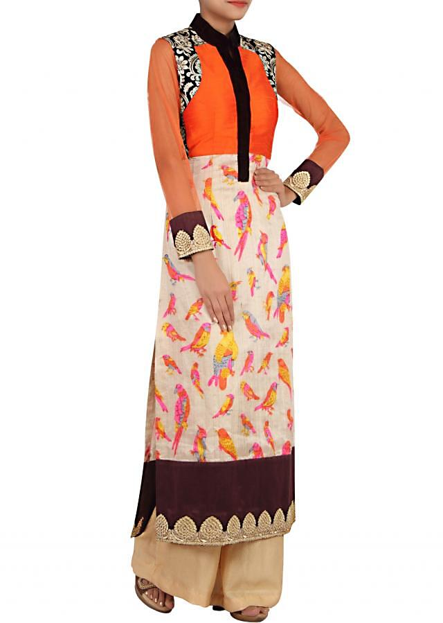 Cream and orange straight fit suit embellished in print and zari embroidery only on Kalki