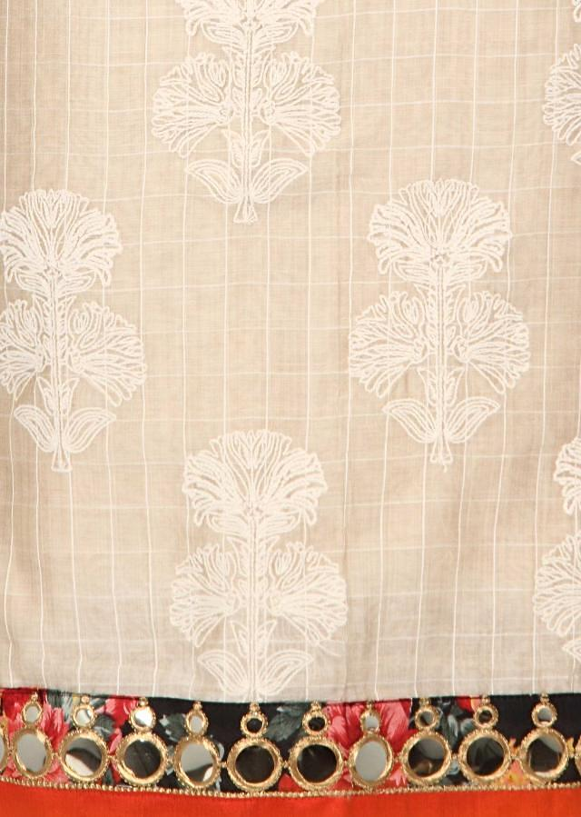 Cream and orange unstitched suit enhanced in thread butti