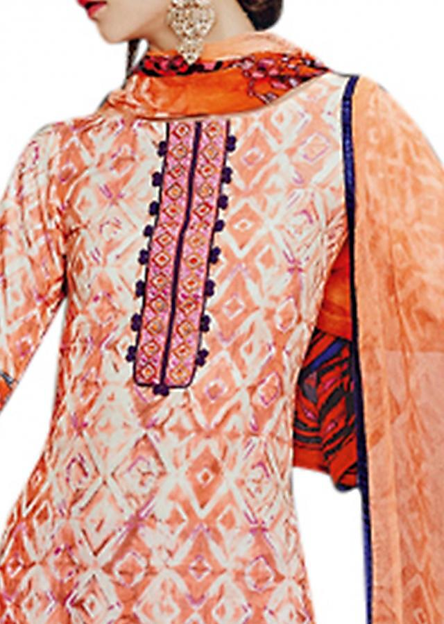 Cream and peach unstitched suit enhanced in resham and print