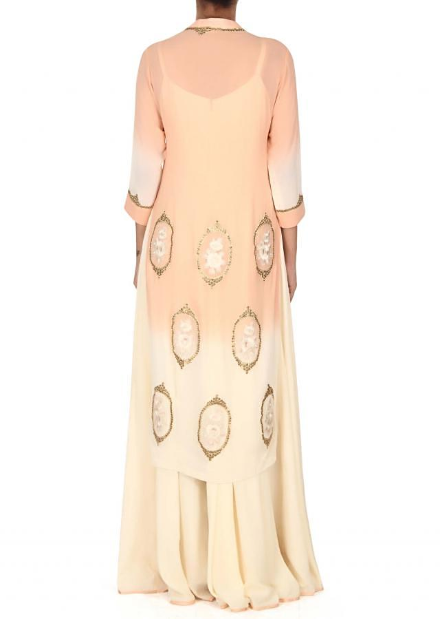 Cream and peach suit adorn in resham and sequin butti only on Kalki