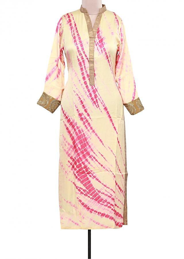 Cream and pink tie and dye kurti adorn in lurex placket only on Kalki