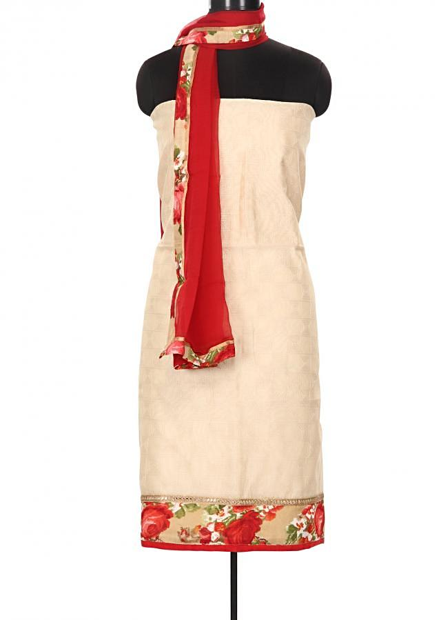 Cream and red unstitched suit enhanced in printed hem line