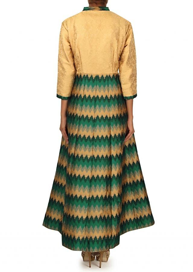 Cream and teal dress enhanced in ikkat motif only on Kalki
