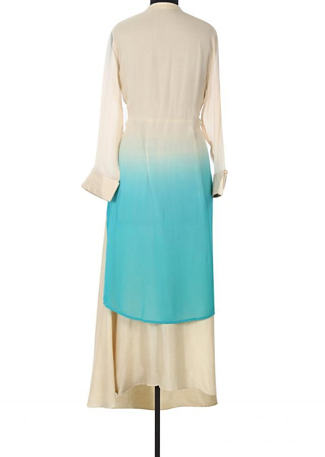 Cream and turq kurti adorn in resham embroidery only on Kalki