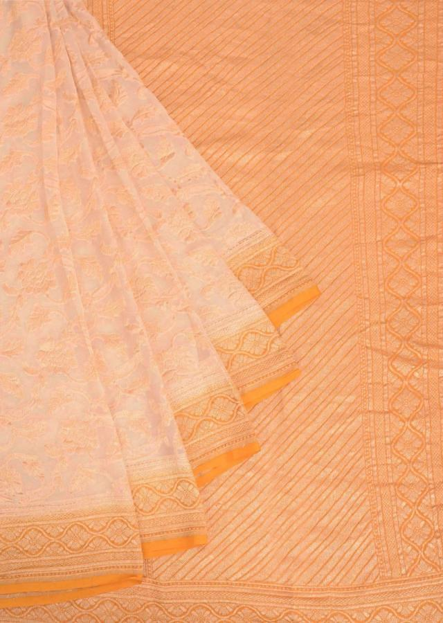 Cream Banarasi Saree In Chiffon Fabric With Weaved Floral Jaal Pattern Online - Kalki Fashion