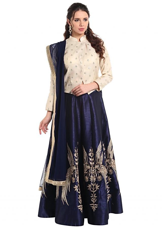 Cream blouse and navy blue lehenga in bird motif embroidery only on Kalki