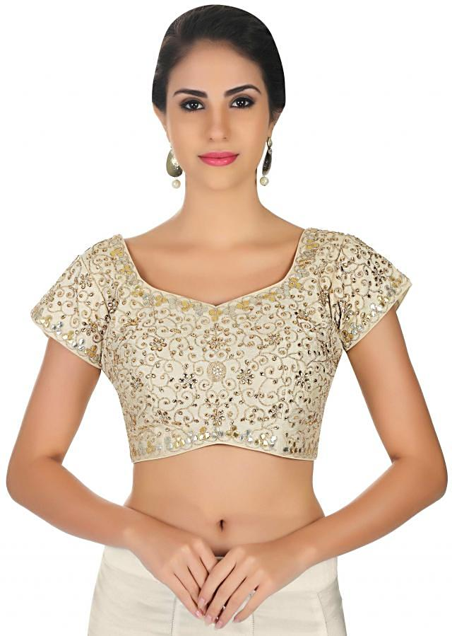 Cream blouse features in raw silk with zari, kundan and gotta patch only on Kalki