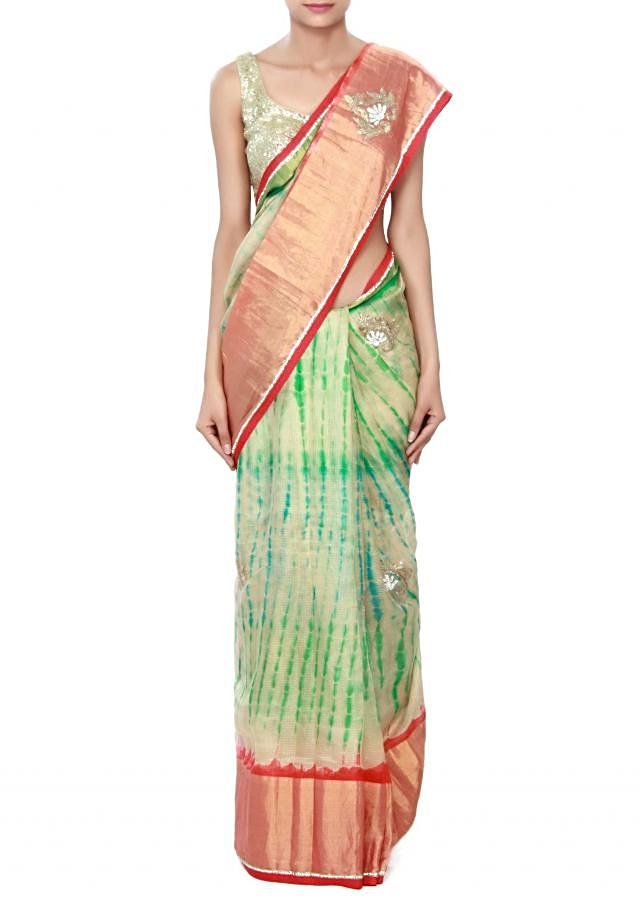 Cream chanderi saree enhanced in embroidered butti only on Kalki
