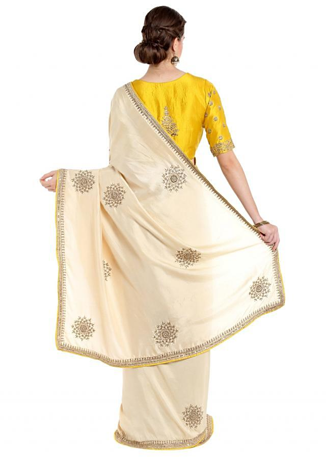 Cream cotton silk saree with sequin embroidered butti and border only on Kalki