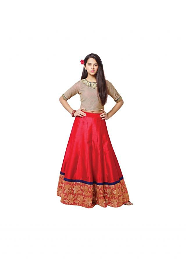 Cream crop top in embroidered neckline with red lehenga
