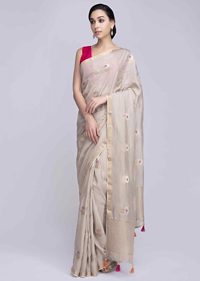 Cream dola silk saree with weaved floral butti only on Kalki