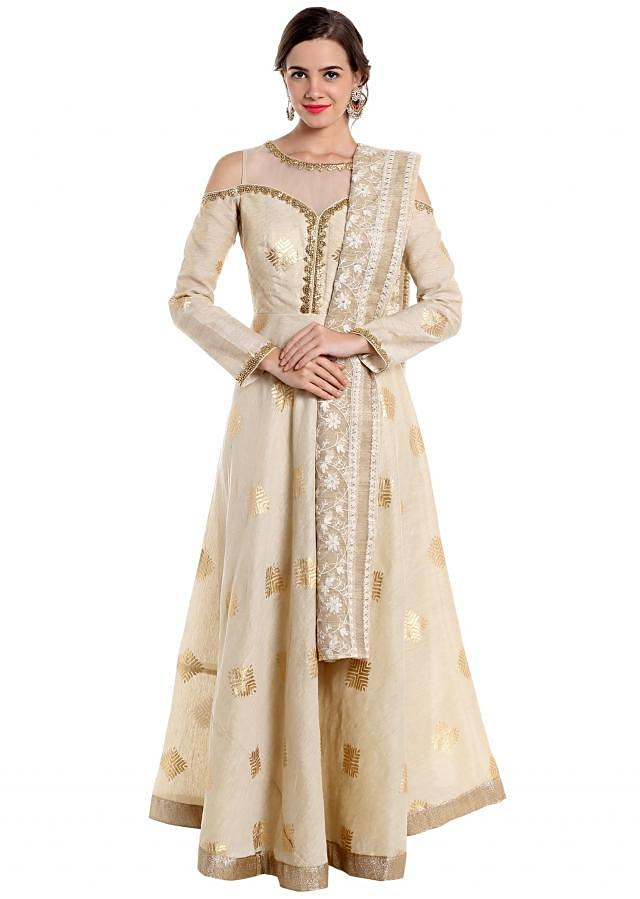 Cream ethnic suit styled with foil print and thread work only on Kalki
