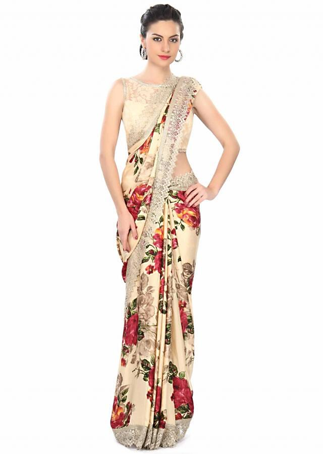 Cream floral saree enhanced in croquet lace border only on Kalki