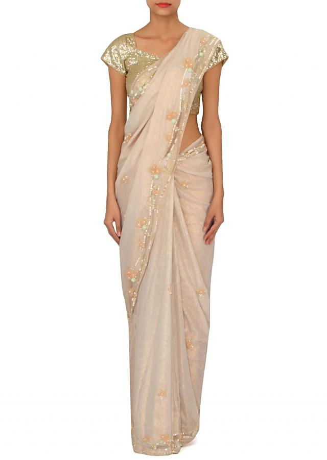 Cream foil georgette saree embellished in 3D flower only on Kalki