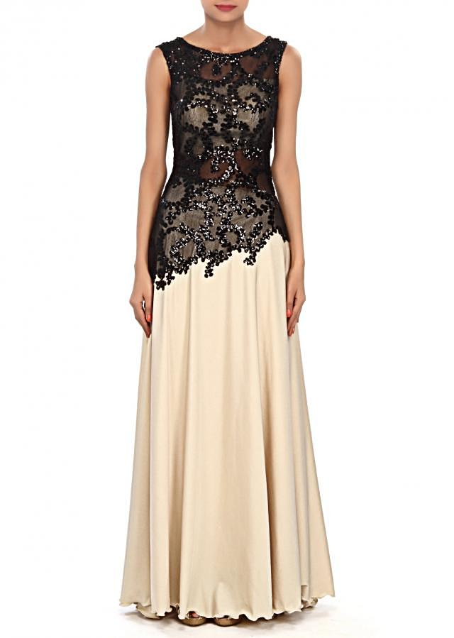 Cream gown embellished in sequin embroidery only on Kalki