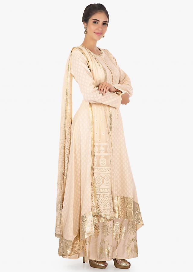 Cream jacquard cotton kurti in foil printed hemline paired with a foil printed palazzo and lucknowi thread work dupatta only on Kalki