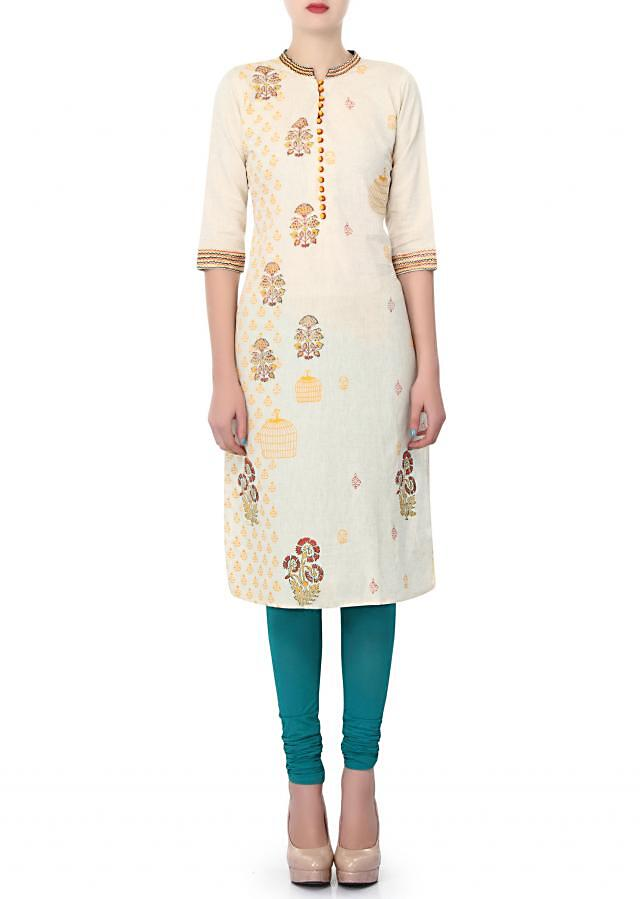 Cream kurti enhanced in printed butti only on Kalki