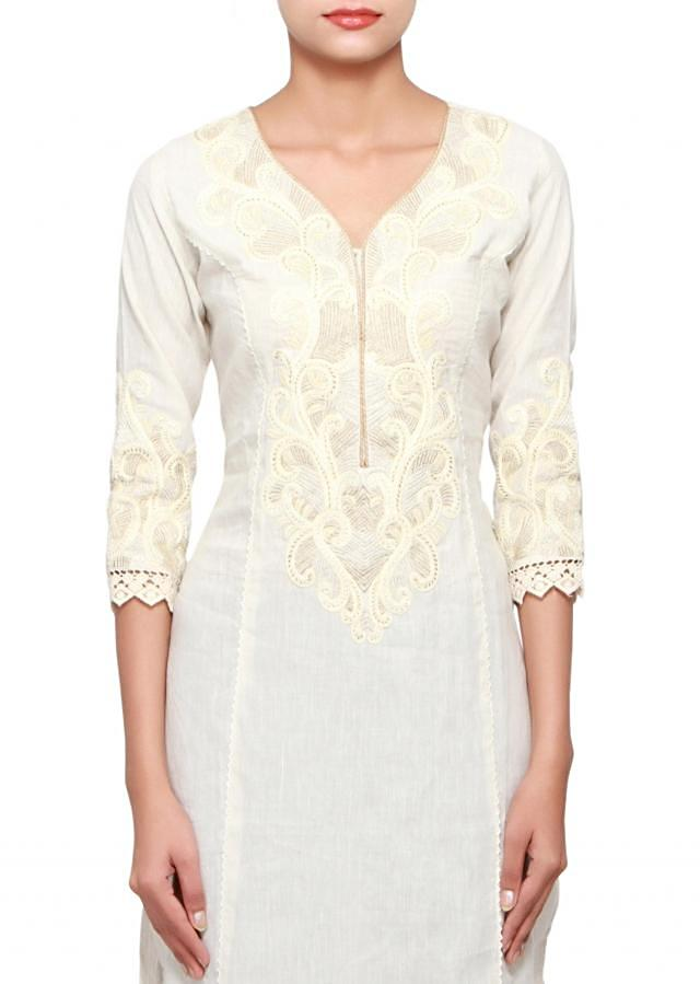 Cream kurti in cotton embellished in thread and zari embroidery only on Kalki