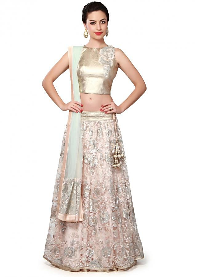Cream lehenga adorn in resham and sequin embroidery only on Kalki