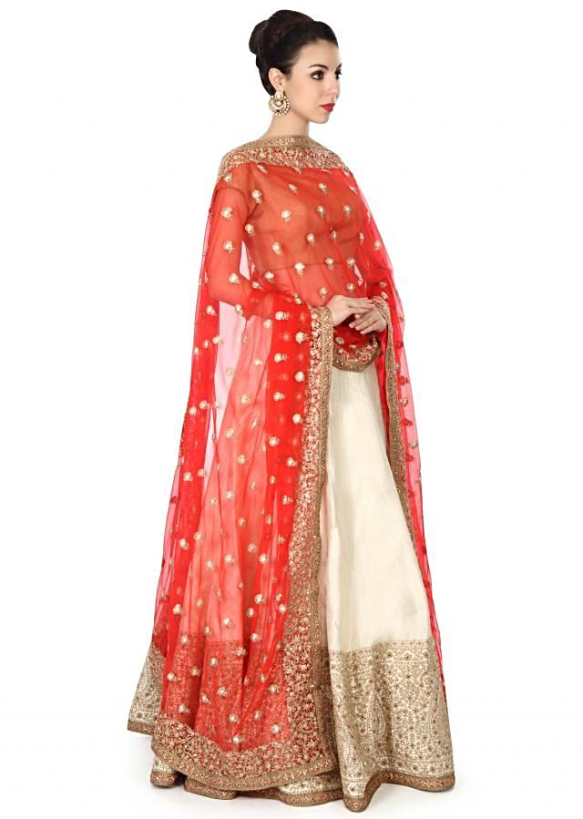 Cream lehenga adorn in zari and sequin embroidery only on Kalki
