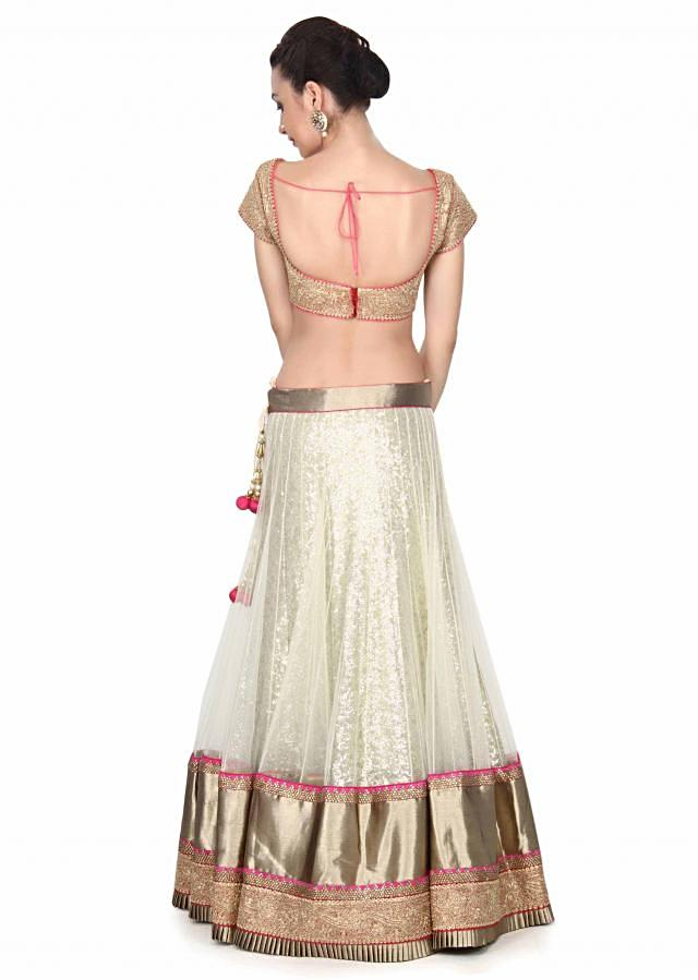 Cream lehenga matched with embroidered blouse only on Kalki