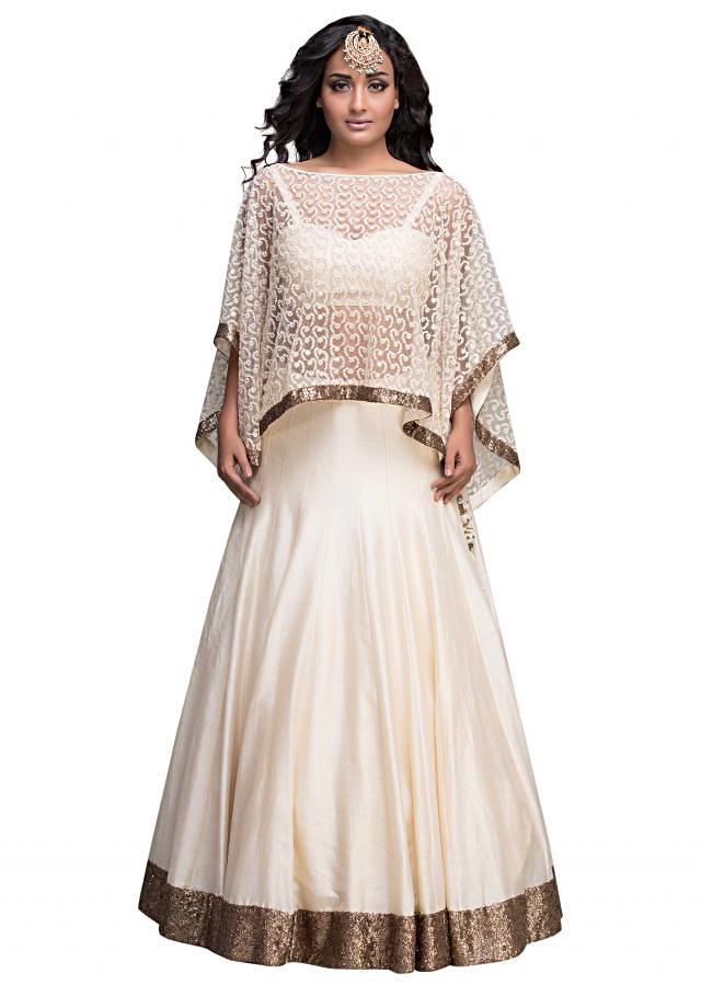 Cream lehenga matched with embroidered cape