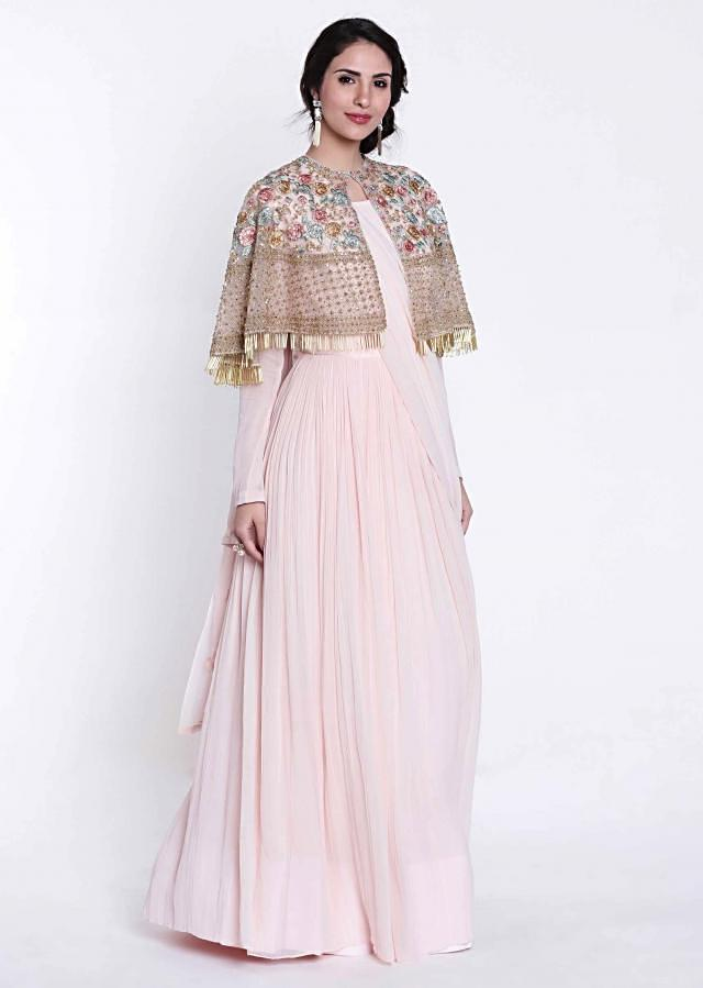 Cream pink suit in fancy drape with embroidered cape only on Kalki