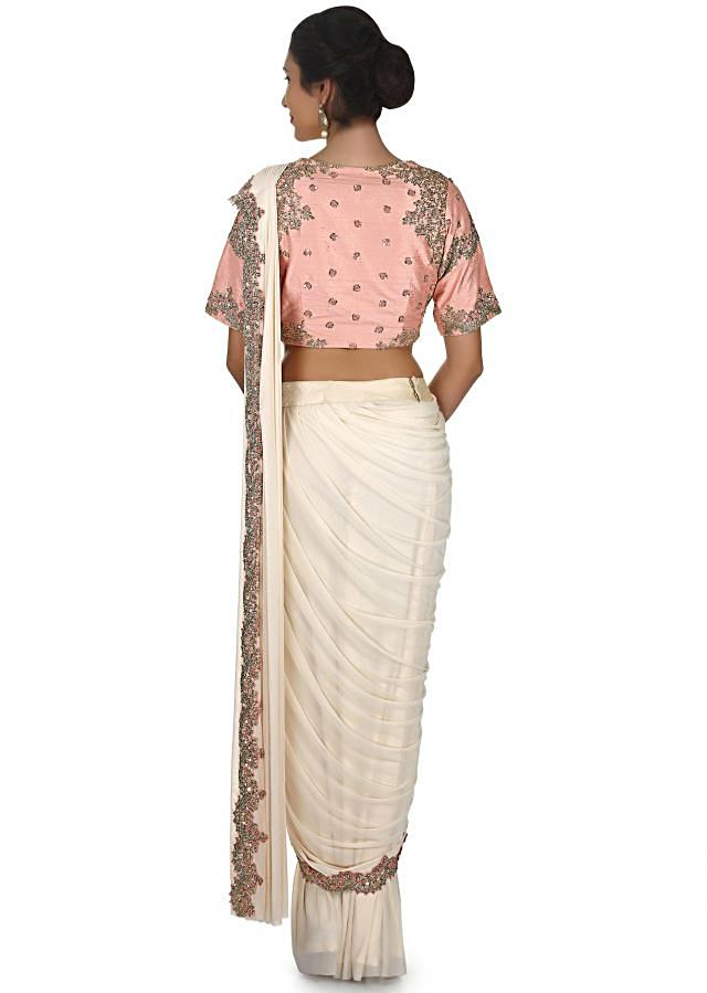 Cream pre stitched saree with french knot embroidered border only on Kalki