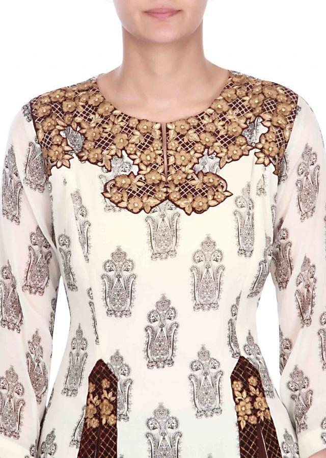 Cream print suit matched with brown skirt only on kalki