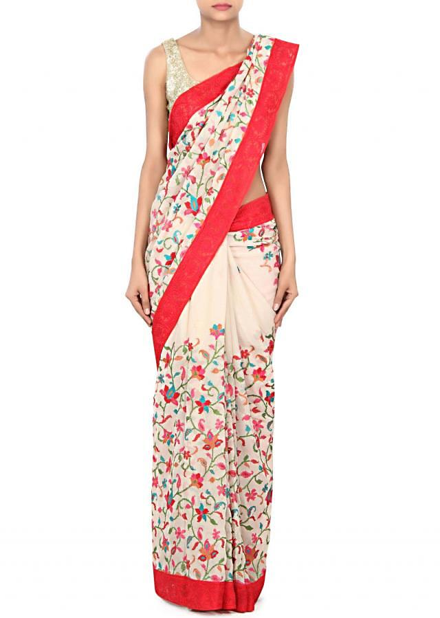 Cream saree adorn in floral and paisley embroidery only on Kalki