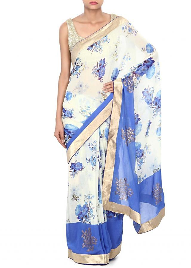 Cream saree adorn in floral print and kundan only on Kalki