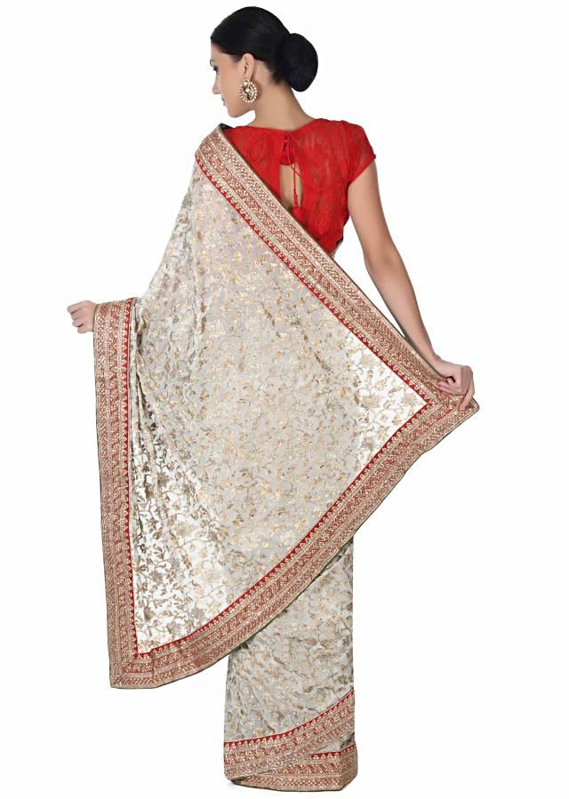 Rose cream saree adorn in zari and sequin embroidery only on Kalki
